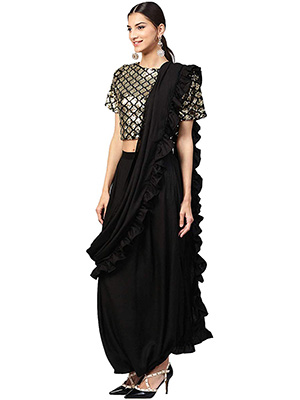 A model wearing dhoti saree with black coloured dhoti and a blouse with golden work on it.