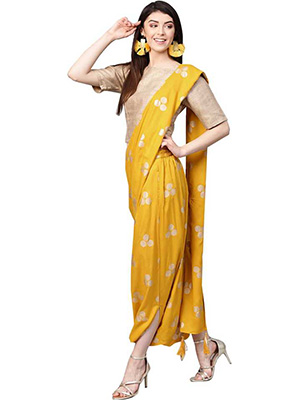 A model is wearing a deep yellow coloured dhoti saree with circle patterns and a beige coloured blouse.