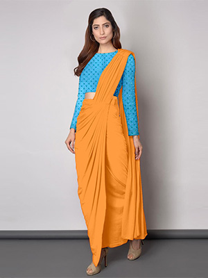A model wearing dhoti saree with yellow coloured dhoti and a sky blue blouse with tiny designs on it.