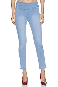 A model wearing a light blue pair of jeggings.