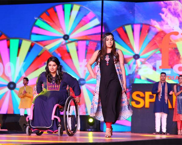 Wheelchair user Virali Modi and Simran Chawla walking the ramp at SPARK.