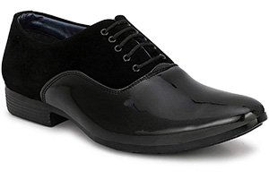 Formal black leather shoe with black laces.