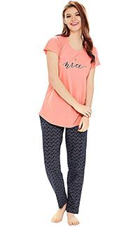 A model wearing a peach top and printed black pyjama.