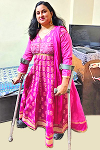 Bhavna wearing a bright pink dress.