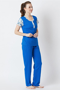 A model wearing a blue top and pyjama.