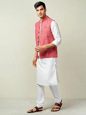 A model wearing pastel coloured nehru jacket on white coloured kurta