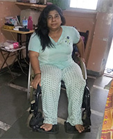 Jaya is wearing a light green pyjama with a light blue top.