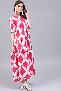 A model wearing a pink and white coloured printed dress.