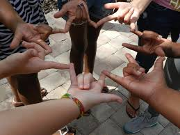 hands held out in a circle forming the love sign
