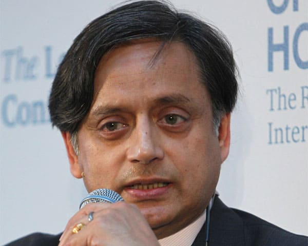 image of Shashi Tharoor holding a microphone