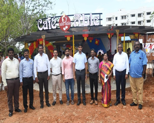 Cafe Able Dream Kitchen team posing for a picture with Collector Sandeep Nanduri