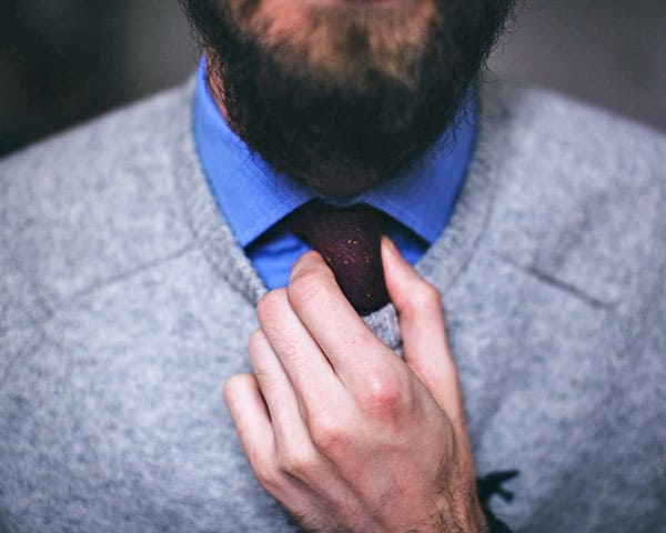 image of a man adjusting neck tie