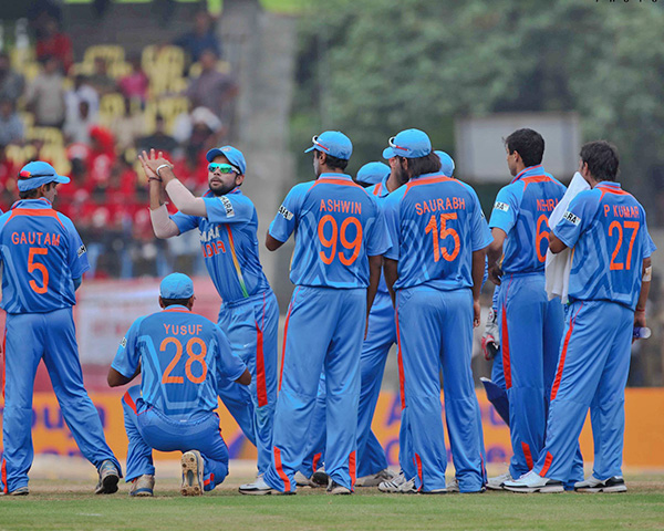 Indian team members in blue