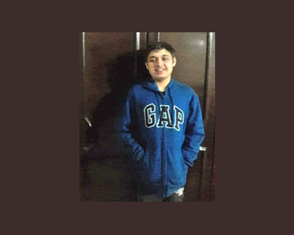 Dhananjay is wearing a hoodie jacket that is dark blue in colour with the word GAP on it.