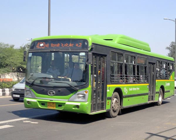 a green bus on the road