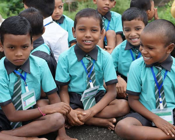 A group of children in school uniform smiling