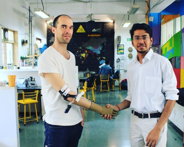 Prashant Gade shakes hand with a user of Inali Arm