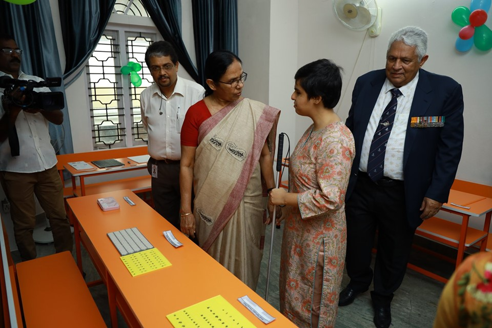Image of Tiffany Brar and Kerala Minister Shailaja talking