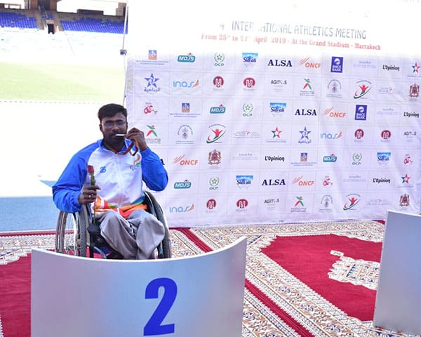 Image of wheelchair racer Manoj kumar