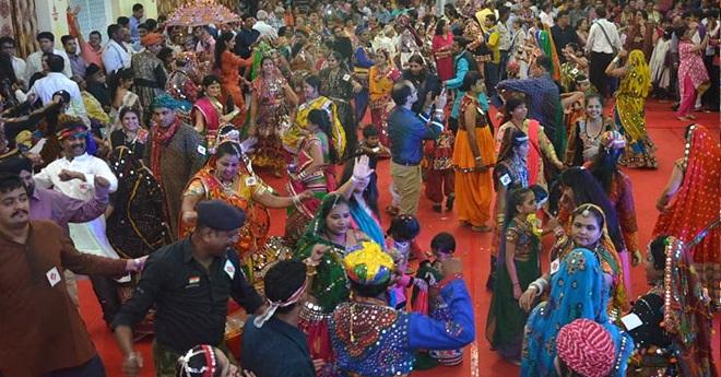 people dancing dandiya