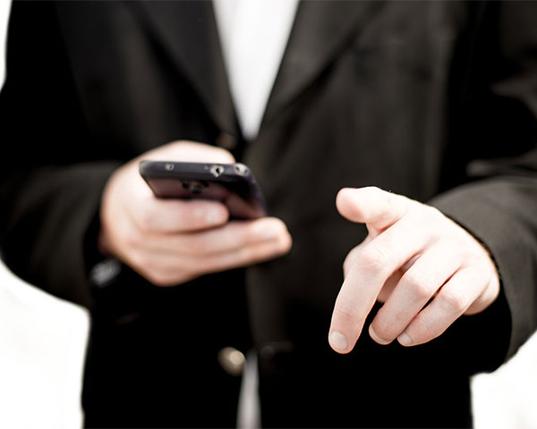 Image of man holding mobile