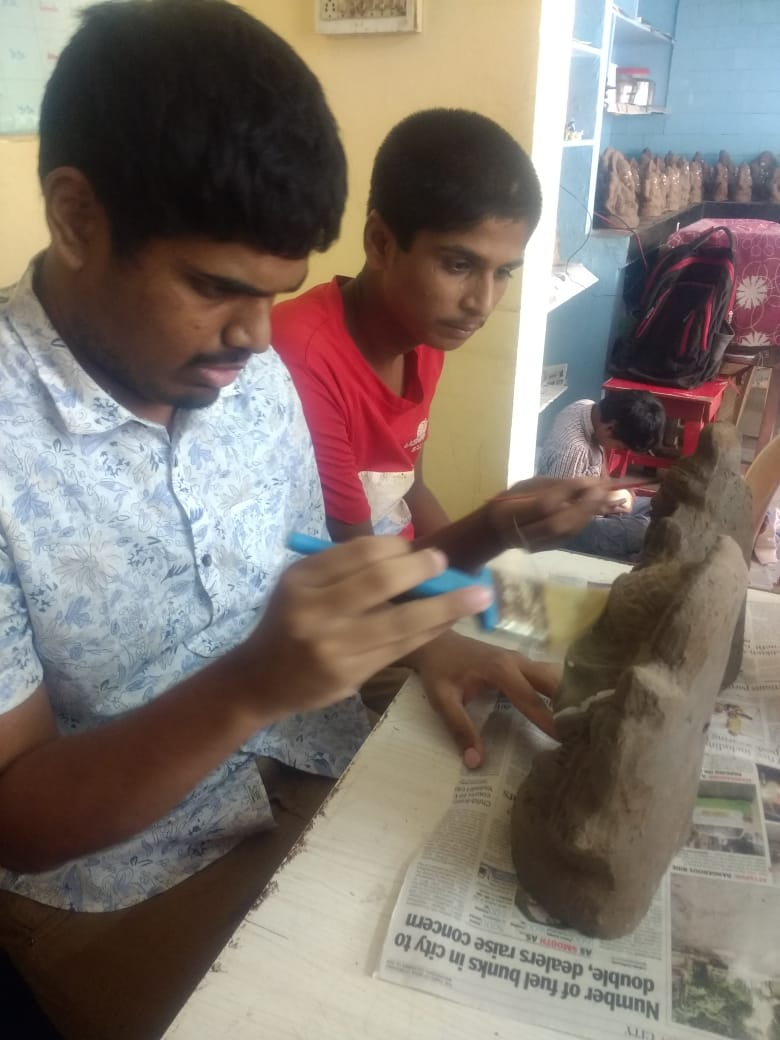 Image of Pragiti students making Ganesha idols