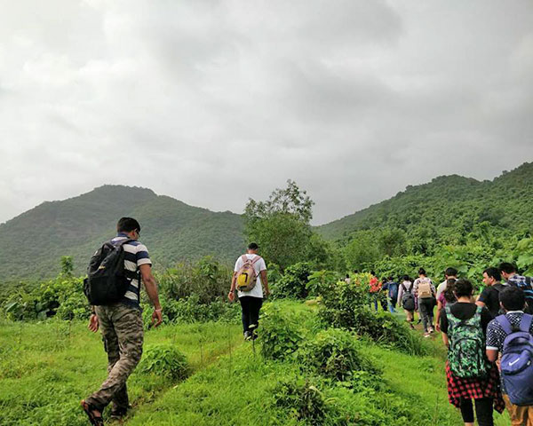 People walking up a hill