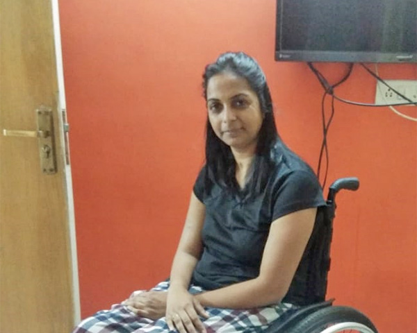 Ritu is wearing a check patterned pyjama with a black top in this picture.
