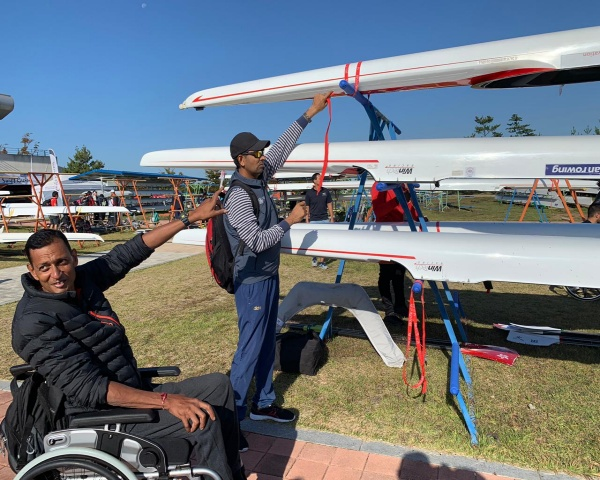Para rower and swimmer Wing Commander Shantanu poses with his boat at South Korea