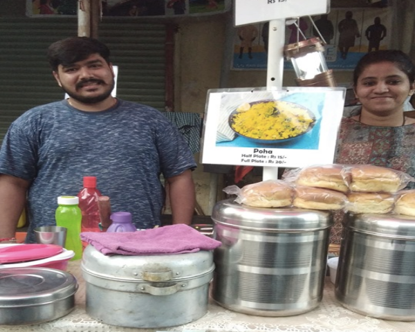 Image of Ashwini Shenoy Shah and her husband at food stall