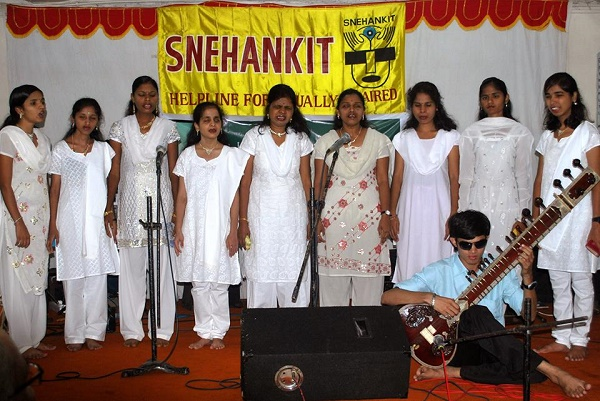 students in white singng on stage