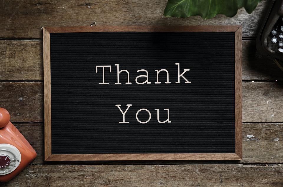 Thank you written on a black board