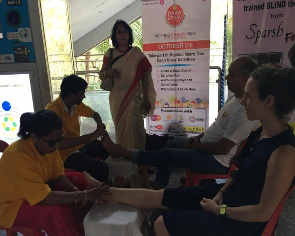 Image of blind massage therapists with clients at Metro station