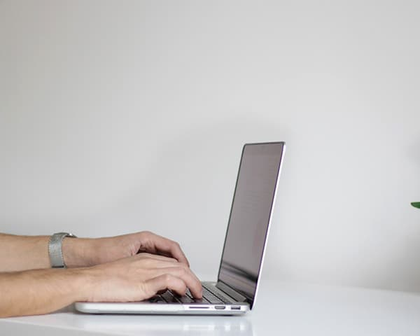 Image of a person typing on a computer keyboard