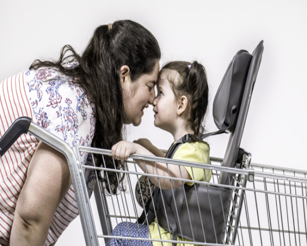Child in a GoTo Shop cart with mother