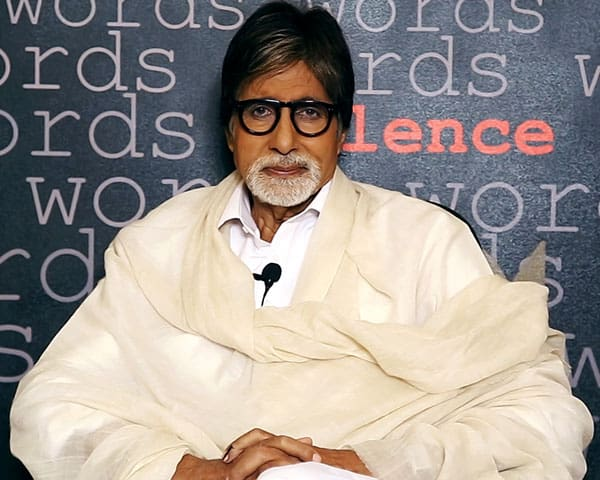 Actpr Amitabh Bachchan seated