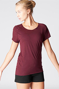 A model is wearing a burgundy coloured T-shirt.