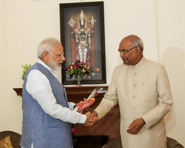 President kovind shaking hands with pm modi