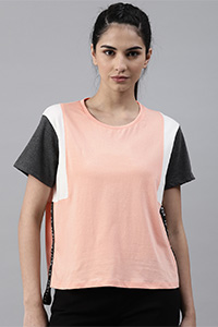 A model is wearing a white, peach and black coloured combination T-shirt.
