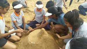 children playing with sand.