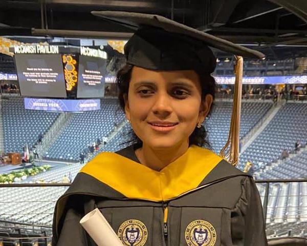 aditi shah holding her degree
