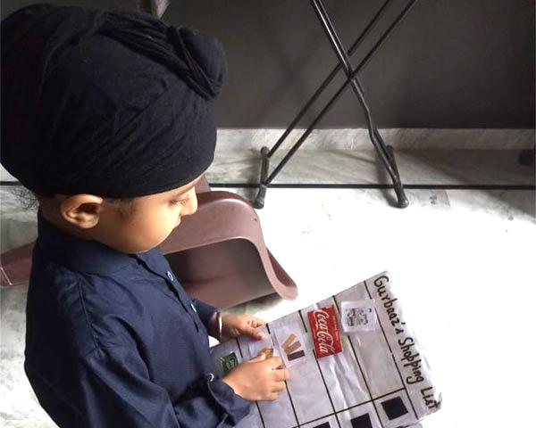 A child preparing his shopping list.