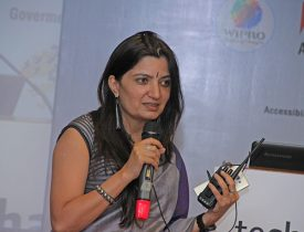 Shilpi KApoor, Founder-CEO BarrierBreak speaking into a mike