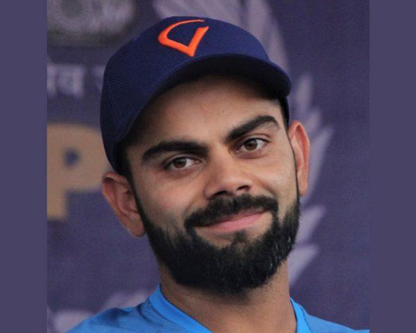 Virat Kohli wearing a cap