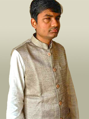 Amar wearing plain grey coloured jacket over a silk shirt.