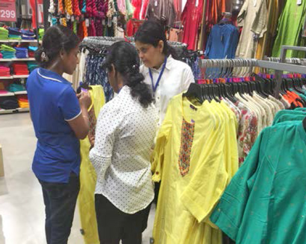 Three female shopping at the Big Bazaar store.