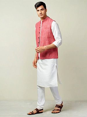 A model wearing pastel coloured nehru jacket on white coloured kurta