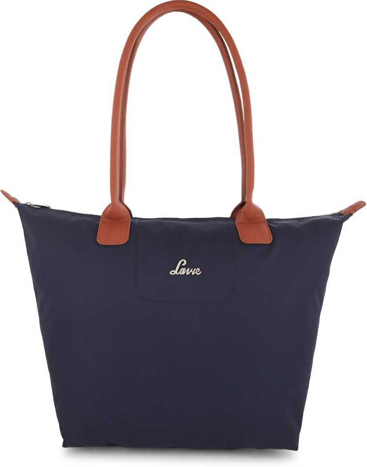 A dark blue coloured hand bag with brown handle.
