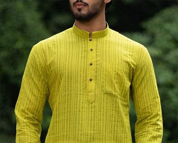 a man wearing a plain yellow kurta