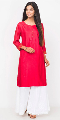A solid bright pink knee kurta with golden embroidery around the sleeves.